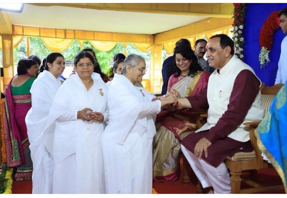 Gujarat : Rakhi with Godly Blessings Peace Power to Shri Vijay Kumar Rupani- Chief  Minister  of Gujarat.