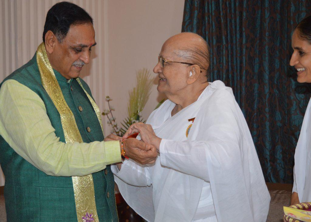 Ahmedabad - Tying Rakhi to Hon. Chief Minister of Gujarat- Vijaybhai Rupani